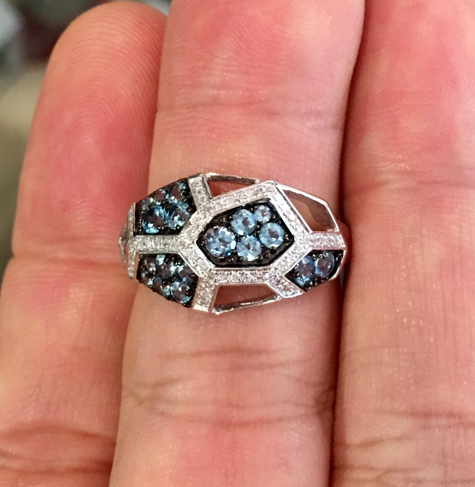 This 14kwg blue topaz ring is a striking contemporary piece sure to add a little pizzazz to any collection.