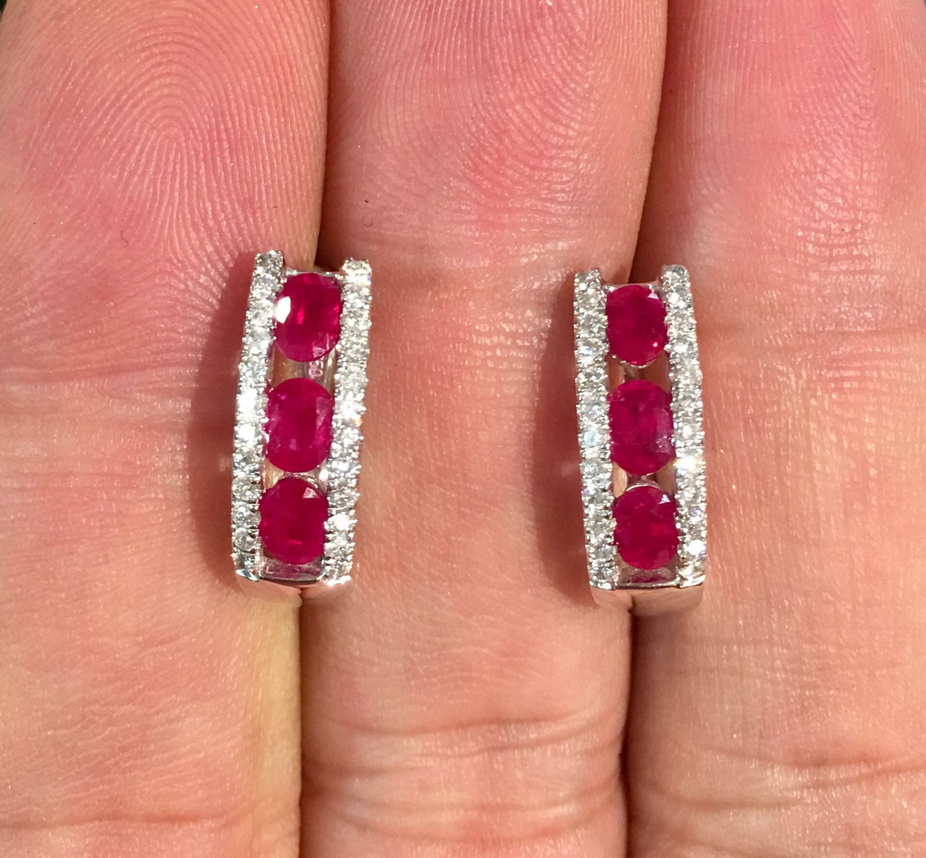 These 18kwg leverback ruby earrings are accented by 1.20 ctw of diamonds - a clean, classic look.