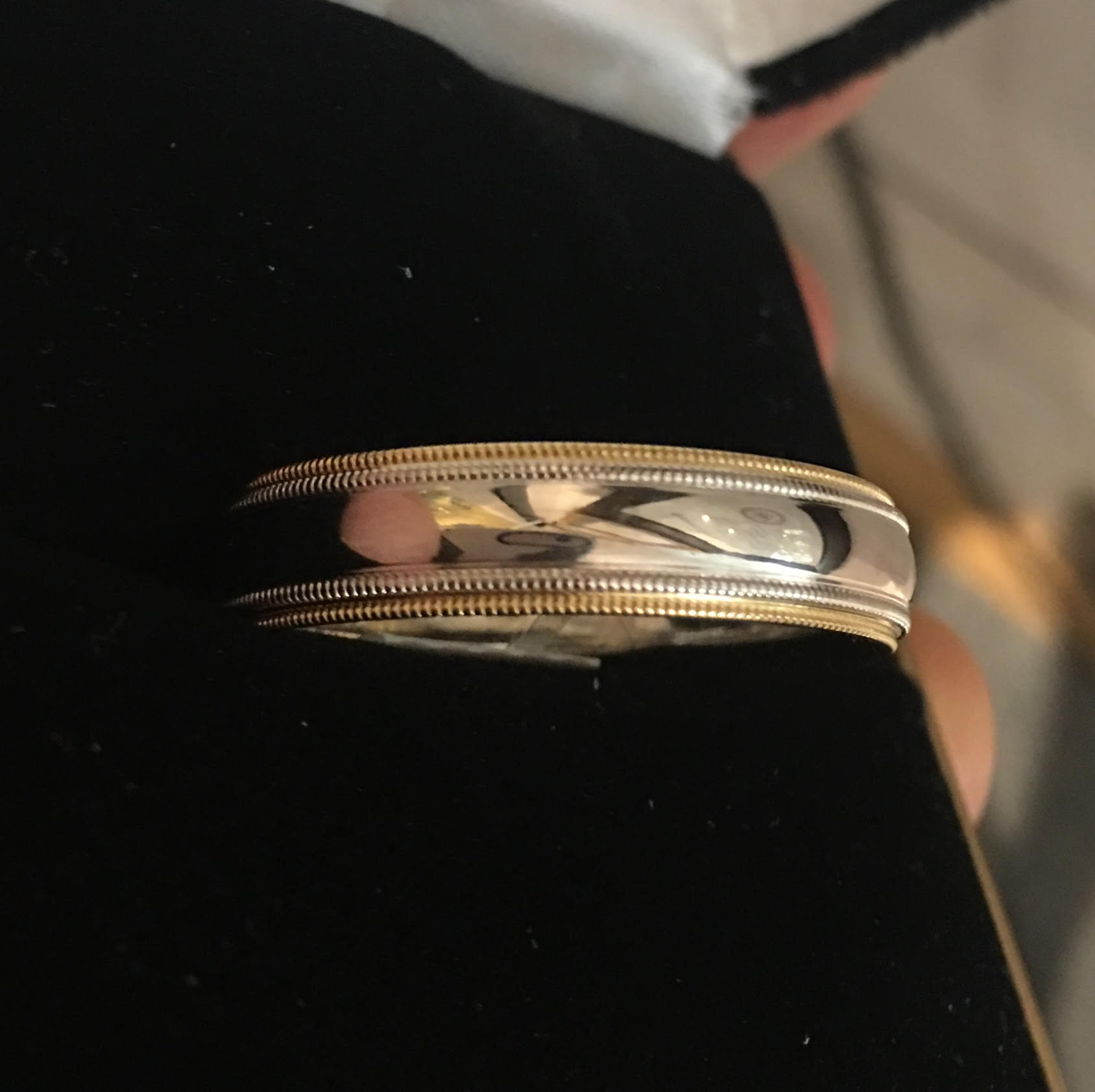 This 14k two-tone milgrain band is a simple, timeless look.