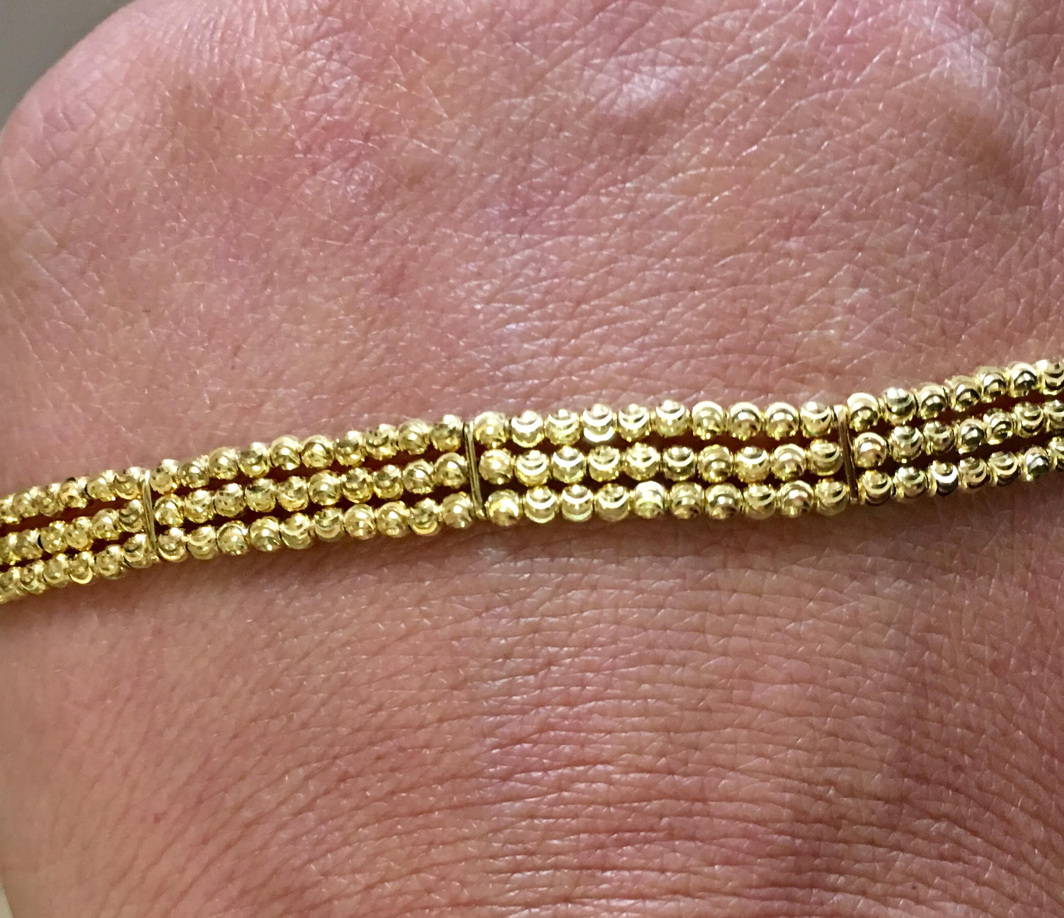 This 14kyg triple strand beaded bracelet is classy, fun, and perfect for any occasion.