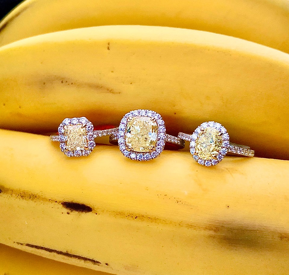 Three stunning yellow and white diamond halo solitaire-style rings are sure to bring the warmth of the summer sun into your heart at any time of the year. Contact us for details on a specific ring, as each is priced differently.