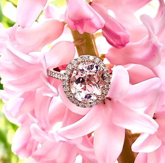 14-karat rose-gold halo-style solitaire set with one blush pink morganite, beautifully subtle like a breath of fresh spring air.